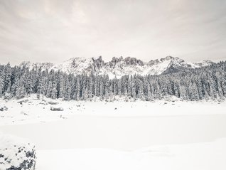 ultra wide angle Lake Carezza winter