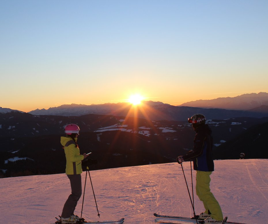 two skier with sunset