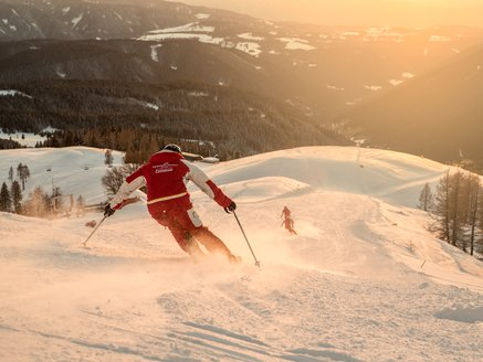Skischool Carezza instructor with sunset