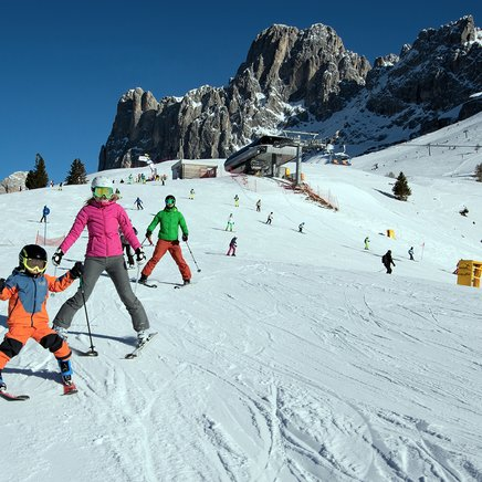 Ski day with the whole family in Carezza