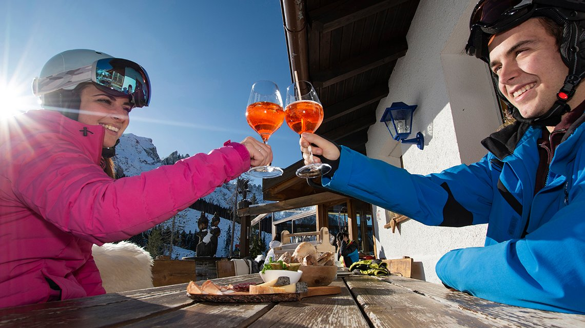 Break with a drink on the slopes of Carezza Dolomites